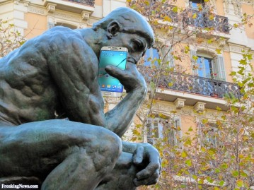 the-thinker-statue-with-a-cell-phone-124371